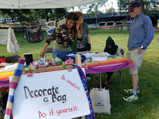 Mariam Mohamad-Sidik worked on a craft at the Lutheran Social Services tent