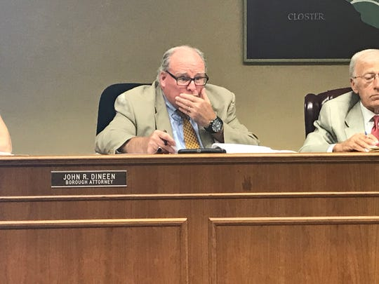 Attorney Jack Dineen and Mayor Paul Hoelscher consider the amendment on the feeding of wildlife at Tuesday's Borough Council meeting.