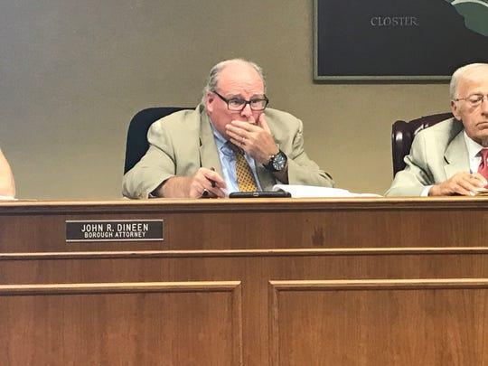 Attorney Jack Dineen and Mayor Paul Hoelscher consider