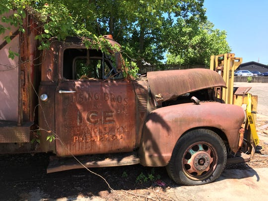 A 1955 delivery truck sits rusting in back of Dusing