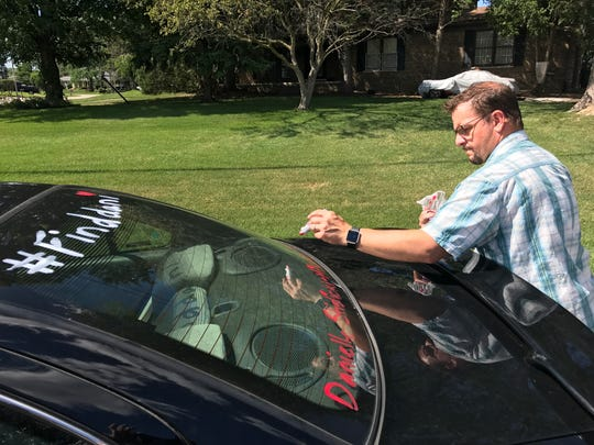 "Chris Paliewicz, the uncle of missing Farmington Hills woman Danielle Stislicki, tags a car window with ""#find dani."""