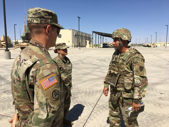 """Command Sgt. Maj. Gerardo """"Jerry"""" Dominguez, right, talks to some soldiers."""