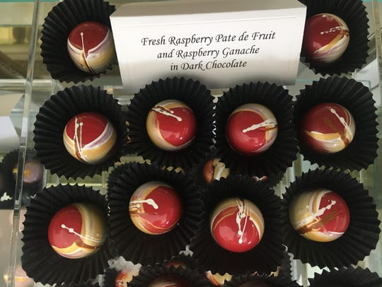 Hand-painted bonbons are seen in the display case at