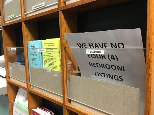 A sign in the city of Tempe's Housing Services office warns there are no 4-bedroom apartment listings left, underscoring the lack of affordable housing for families.