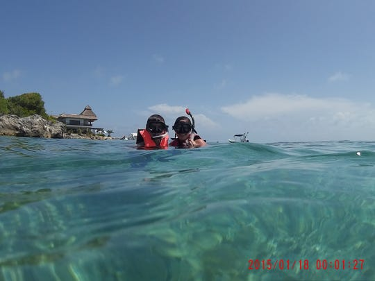 Seth and Carol Ann Warren snorkel the clear waters of Playa Mujeres, Mexico, on their honeymoon.