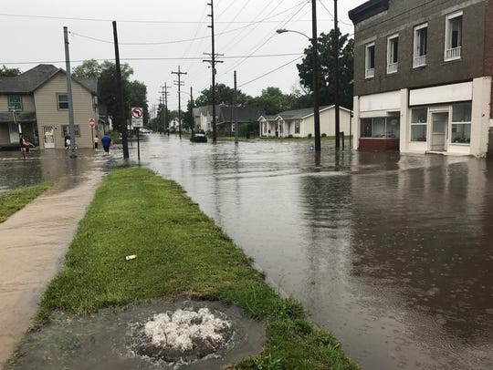 Flood waters filled the streets at the intersection