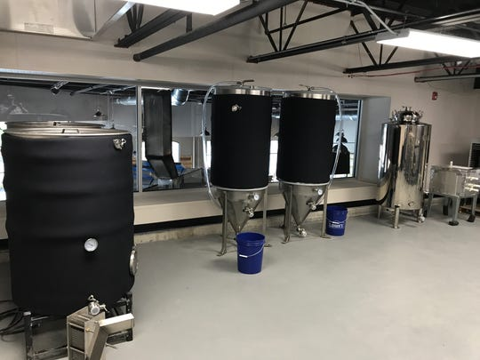 The second-floor 3-barrel brewhouse at Penfield's WhichCraft