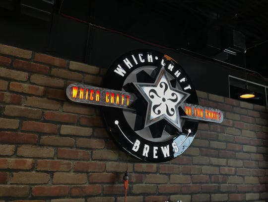 Penfield's WhichCraft Brews light-up logo.