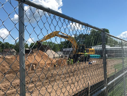 Workers prepare for the new Kwik Trip store on East