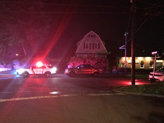 A Ridgewood police car was parked with its light flashing