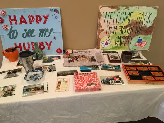 Welcome home signs adorn a table in the fellowship