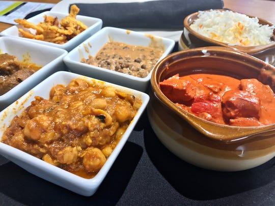 The $9.99 lunch special from Spice Club Indian Grill comes with all of the above.