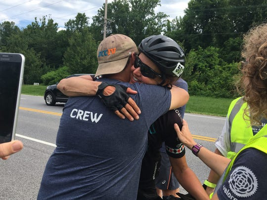 Sarah Cooper hugs members of her support crew at the official finish line of the Race Across America on Sunday, June 25 in Annapolis, Md.