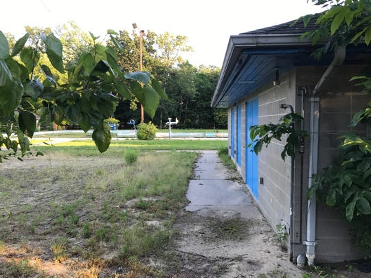 The swim club's abandoned property is overgrown with
