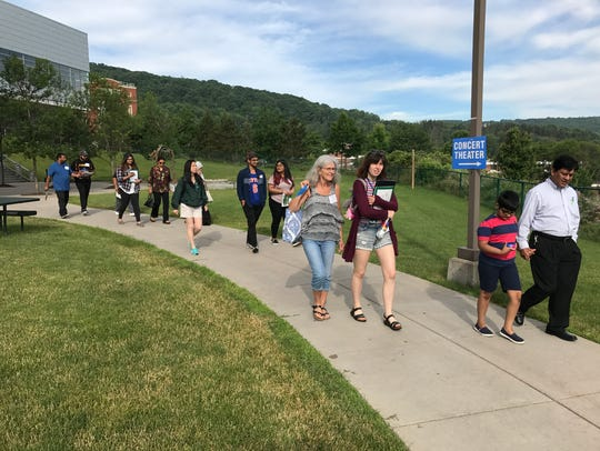 Incoming students and their families tour the Binghamton
