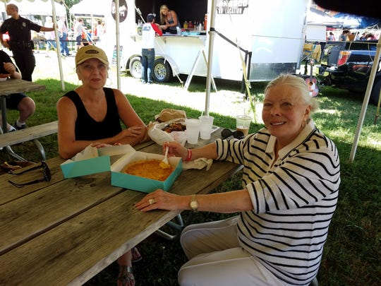 You don't need to rely only on food trucks for lunch at the Bazaar. Pamela Rhodes, left, and Jane Gibbs dig right into their Be Happy Pie Company coconut pie for lunch.