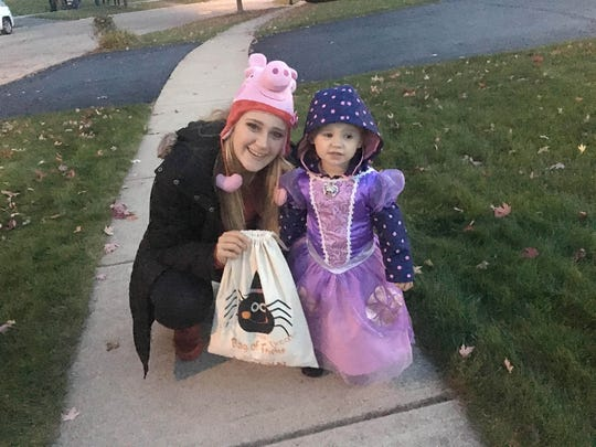 "Kennedy Griest takes daughter, ""Princess Adalyn,"" trick-or-treating on Halloween."