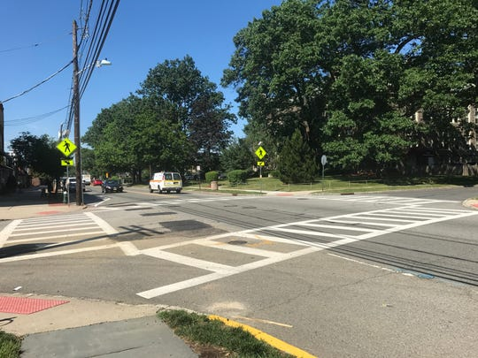 Crosswalks and pedestrian crossing signs are seen at