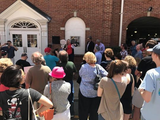 Alyssa Bradley of Clean Water Action speaks to a group of environmental advocates protesting proposed EPA cuts outside the Morristown office of Rep. Rodney Frelinghuysen June 27, 2017.