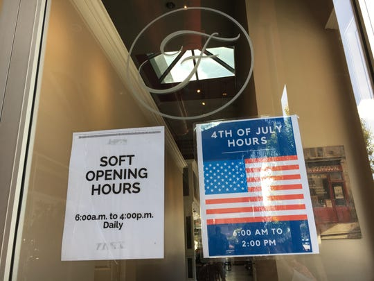 Soft-opening and holiday hours are posted on the doors at Cafe Ficelle in midtown Ventura.