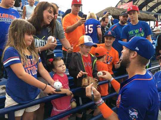 Tim Tebow signs autographs for Jennifer Pedrick and