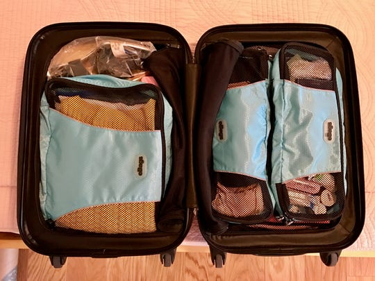"""For this four-night/three-day trip, everything fits perfectly into a 19-inch carry-on suitcase with room to spare. Packing cubes, which act like """"drawers,"""" are a great way to keep similar items organized."""