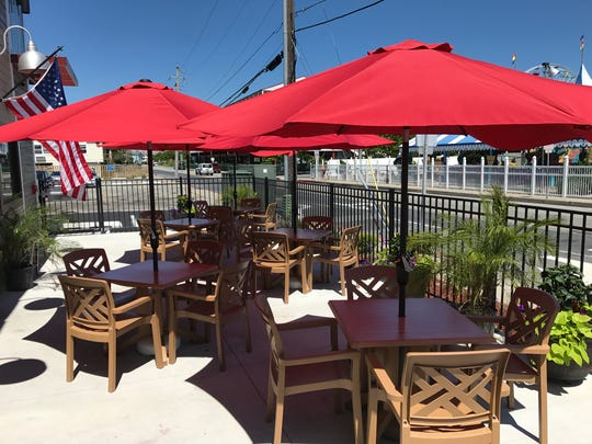 The exterior of Dry Dock 28, a newly opened restaurant in Ocean City, includes outdoor patio seating. 28 June 2017.