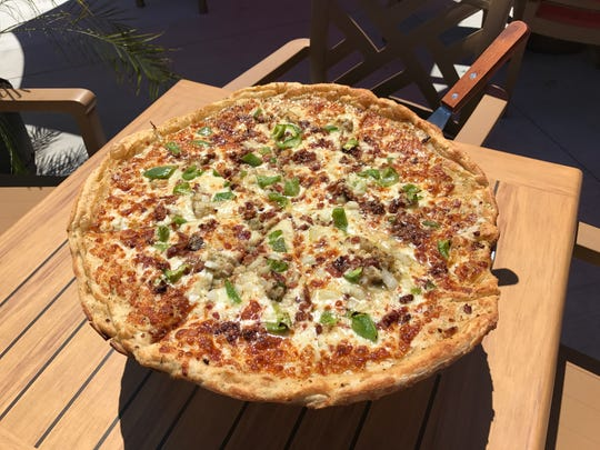 The Casino pizza at Dry Dock 28 includes diced clams, peppers, onions and bacon. 28 June 2017.