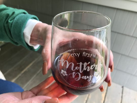 "Sandy Whelton shows her ""First Mother's Day"" wine glass"