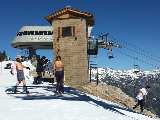 Fit, scantily clad people skiing at Mammoth Mountain Resort on June 28, 2017. A professional photographer was capturing their exploits for posterity.