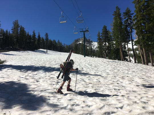 Daniel Ellsworth of Reno hikes through sun-cupped snow at Kirkwood Mountain Resort on June 24, 2017.