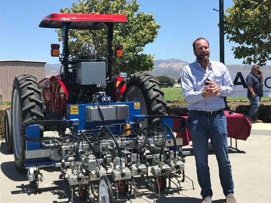 Automated farm machinery cuts down on the need for workers, said Bartley Walker president of Agcess.
