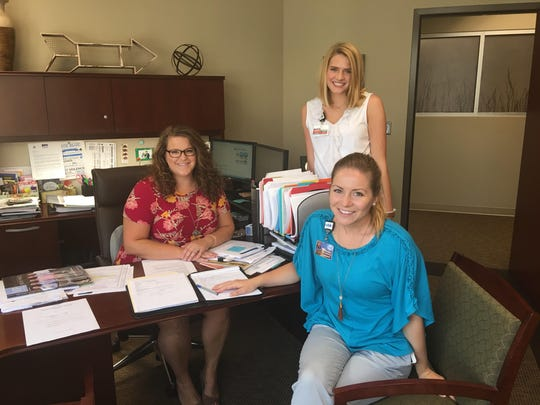 Katie Hartman, center, has been working in  Murfreesboro Medical Clinic's marketing department alongside mentors Lauren Knox, left, and Phoebe Wilkins, right