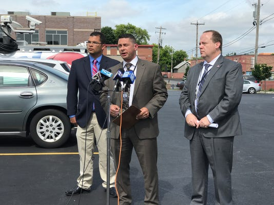 Detective Nathan Butz and the members of the Milwaukee Police Department's homicide division