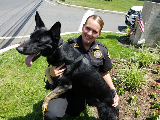 K9 Basilone and his handler, Officer Shannon DiNella,