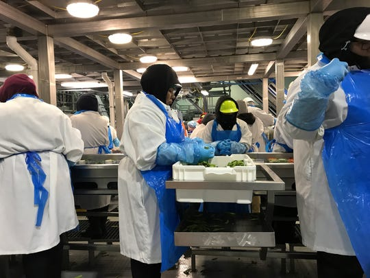 Workers at Taylor Farm's Gonzales processing plant