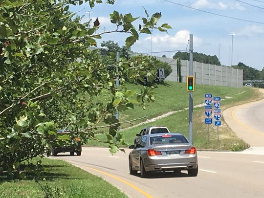 Knoxville traffic engineers requested near side signals installed on poles along Papermill Drive to enhance visibility for drivers. The signals are outlined in a yellow background to improve visibility.