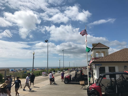 The boardwalk on Rehoboth Beach begins to bustle as