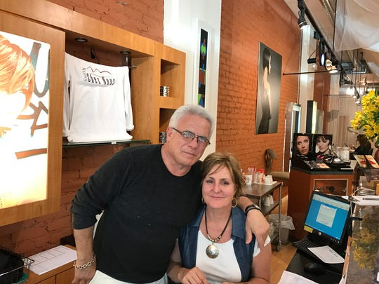 Carmen Malleo, owner of Salon Chez Nous, and employee