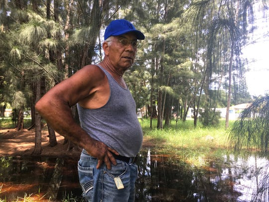 Tony Rodriguez of Cape Coral stands in front of a toxic