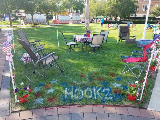 "A group's setup with the ""Hook2"" spray-painted on the"