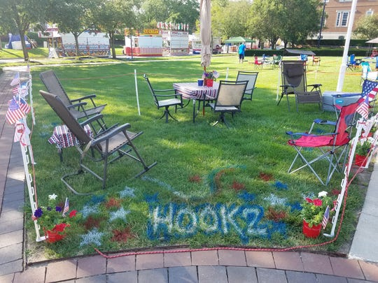 "A group's setup with the ""Hook2"" spray-painted on the grass near the Carmel Gazebo."