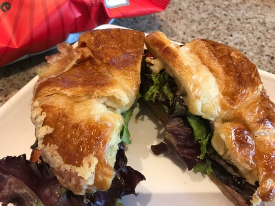 The Rylie's Favorite is a ham and brie cheese sandwich with lettuce and oven-roasted tomatoes.