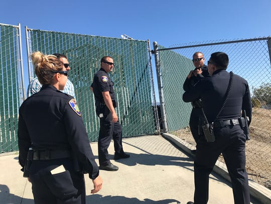 Salinas Police Officers respond to a call from residents