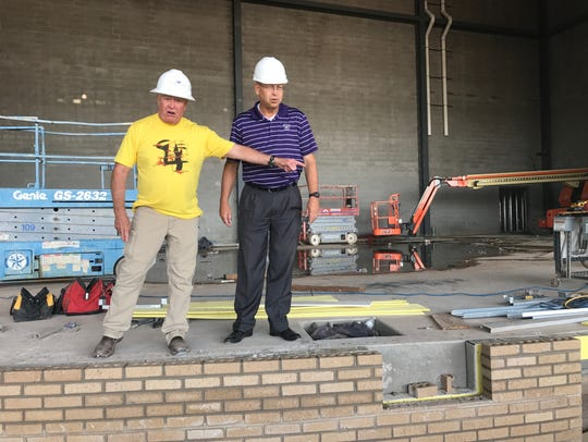 Charlie Barnes, left, project superintendent for W.B.
