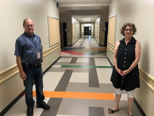 Joe Humphrey, construction coordinator at the Abilene Independent School District, and Director of Early Childhood Jenny Putnam show off the wide hallways of the addition built on to what was Jane Long Elementary. The facility was closed in 2016 but  reopened for the 2017-18 school year as Long Early Learning Center after extensive interior work.