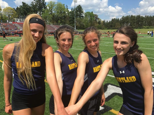 Hartland's 800-meter relay team of (from left) Lindsey