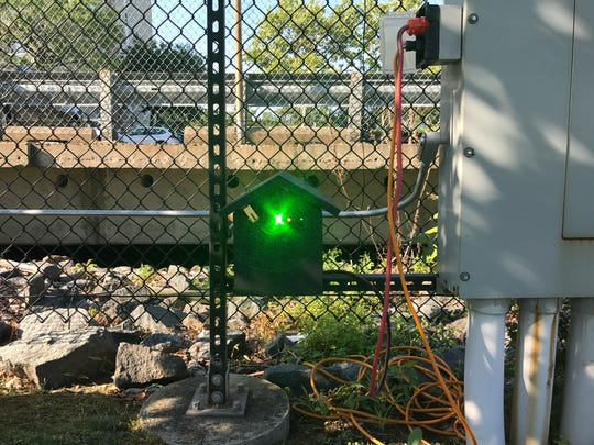 Laser light projectors used for Christmas displays  intermittently flash red and green lights to scare geese away at the Edgewater marina.