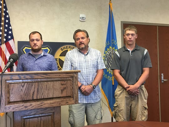 Michael Voigt, center, was recognized July 6, 2017, for his efforts in helping save brothers Andy Morris, left, and Brayden Nielsen, right, in June when they swam too far out and couldn't get back to shore.
