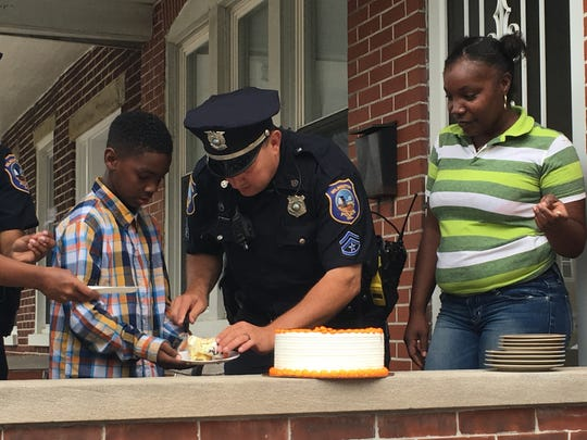 Master Cpl. Lorne Pederson helps 11-year-old Jarrell Turner to some birthday cake after surprising the boy at his Hilltop home.